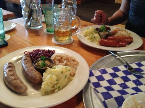 The generously portioned sausage plates -- Kase-wurst in back, bratwurst in front.