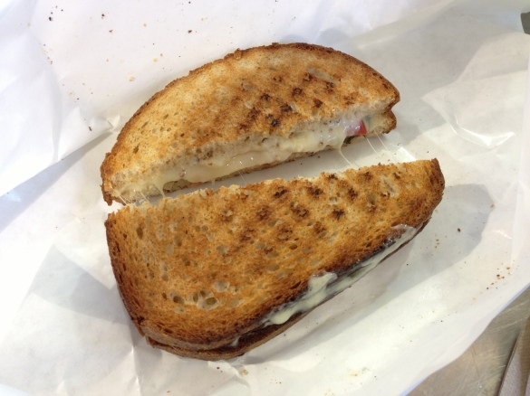Our Flagship Sandwich -- look at that gooey cheese resisting separation.