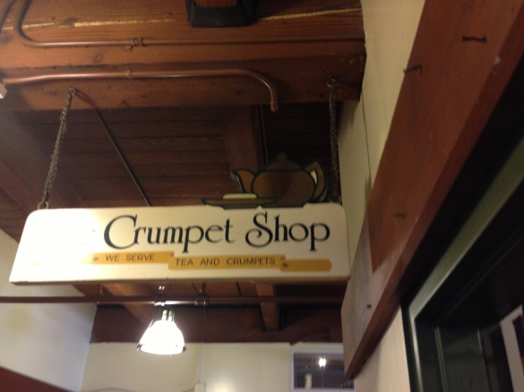 The small sign announcing the entrance to the Crumpet Shop, tucked away from the noise of Post Alley.
